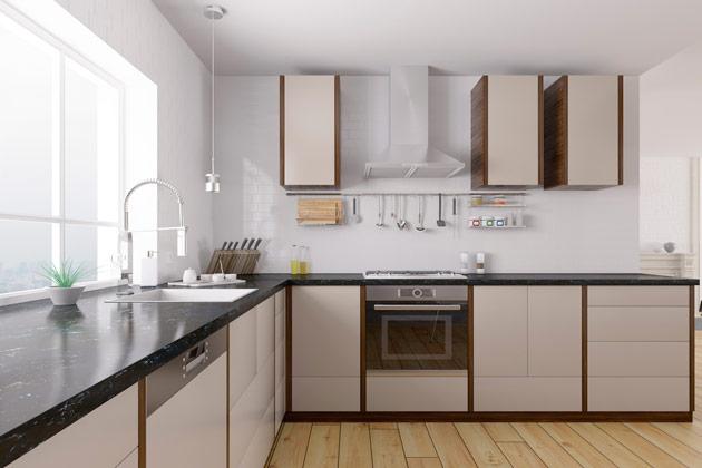 Bancada da cozinha com projeto escuro de cores dos granitos